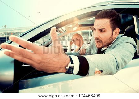 Dangerous city traffic situation, man driving a car.