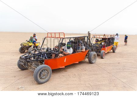 HURGHADA EGYPT - MAY 18 2015: Tourists ready to race in desert
