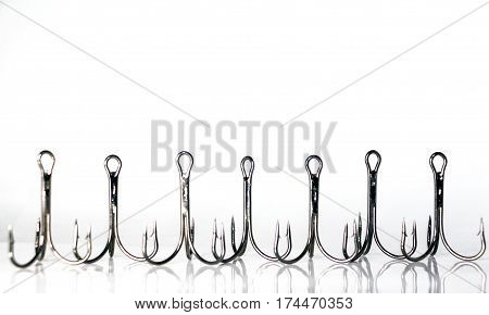 Fishing triple hooks on a white background