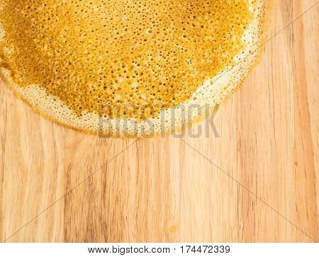 Thin Pancakes On A Wooden Background Top View. Fresh Homemade Crepes