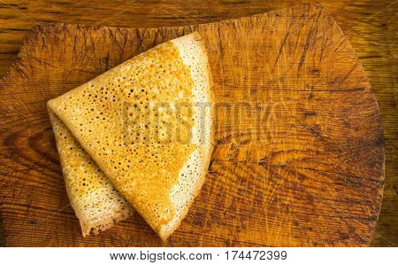 Thin Pancake On A Wooden Background Top View