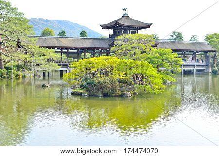 Old roofed bridge in a garden at Heian Jingu of Kyoto Japan