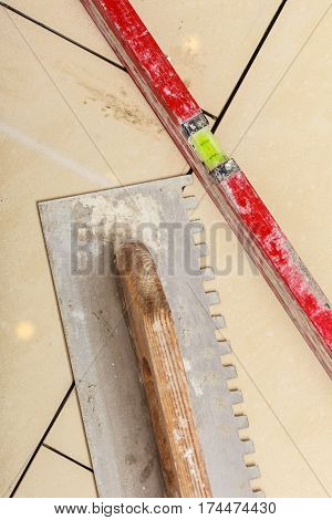House renovation tools and objects concept. Trowel for smoothing cement indoor shot.
