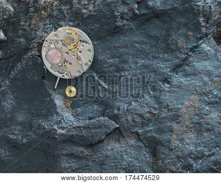 Disassembled Clockwork On A Black Stone