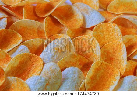 Close up potato chips on wood top view background.