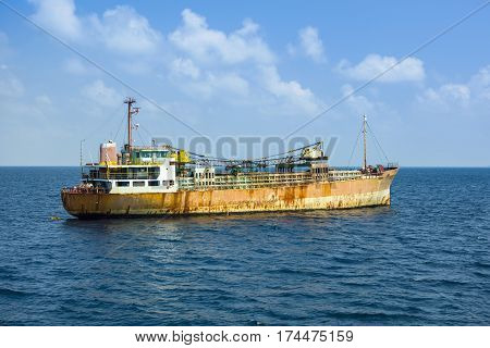 MALE MALDIVES - AUGUST 08 2016 : Cargo ship on the Indian ocean Maldives August 08 2016
