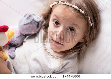 Little Girl With A Quizzical Expression