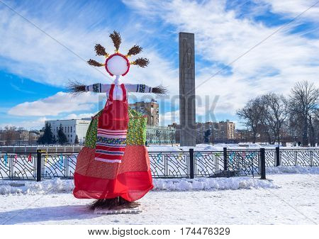 ORYOL, RUSSIA - FEBRUARY 26, 2017: Straw effigy called Maslenitsa is attribute of Russian Carnival, that represents evil is burned at the end of the day