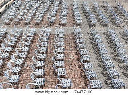 Lot of metal chairs in a rows