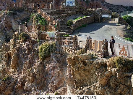 Almeria Spain: December 23 2016: Tourists enjoying beautiful view of Las Sirenas in the Cabo de Gata-Nijar Natural Park. South-eastern corner of Spain
