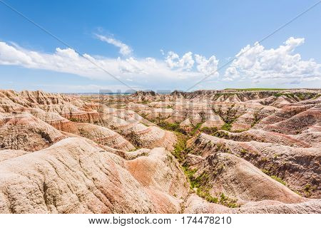 Badlands red canyons in South Dakota with blue sky