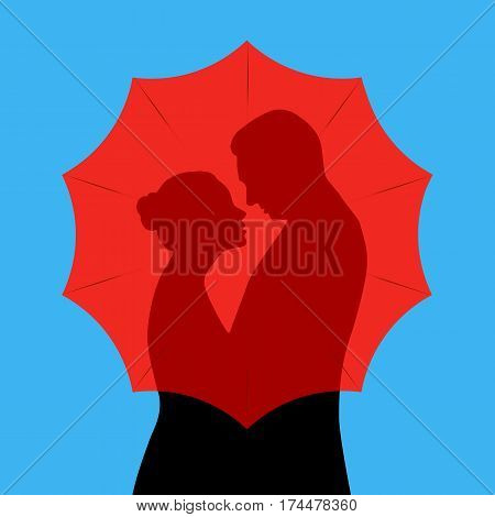Man and woman hiding behind red umbrella