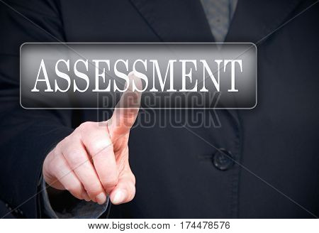 Assessment - female hand with touchscreen button