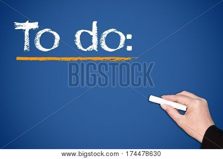 To do - female hand writing text
