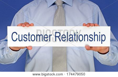 Customer Relationship - Manager holding sign with text