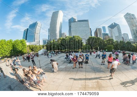 Chicago USA - May 30 2016: Chicago bean in Millennium Park with many people and buildings in background closeup