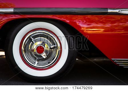 The white wall tires of a 1958 vintage American car in southern California.