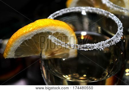 Focused glass of vermouth with a slice of lemon, thinly lined top of the glass with a layer of sweet sugar in the restaurant, Novi Sad, Serbia