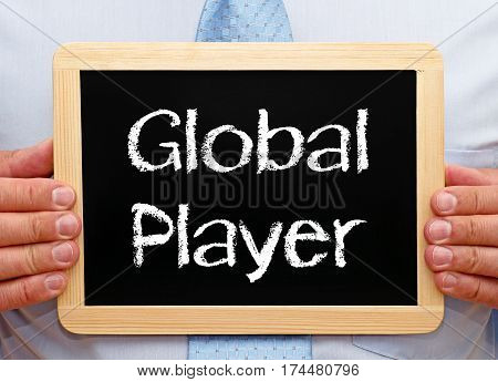 Global Player - Manager holding chalkboard with text