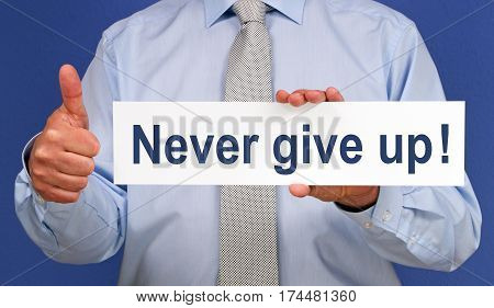 Never give up - Manager with sign and thumb up