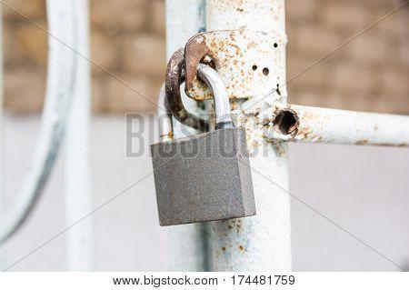 Close-up image of hanging metal new padlock