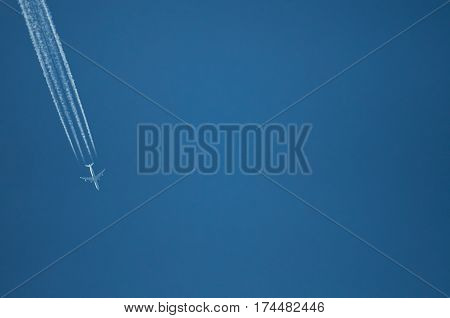 One Plane Fly On Blue Sky Background