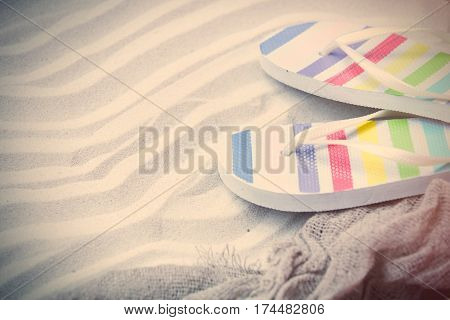 Beautiful Colorful Sandals And Cool Fishnet Lying On The Wonderful Beach Sand Background
