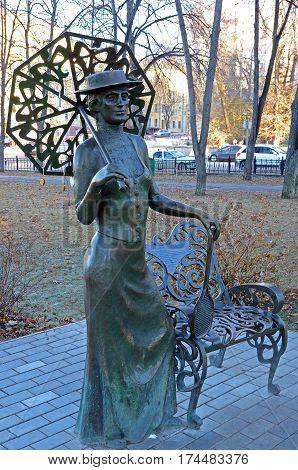Samara Russia - Nov20 2016: The sculptural composition Lady with a racket in autumn Samara