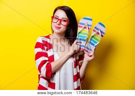 Beautiful Young Woman With Colorful Sandals Standing In Front Of Wonderful Yellow Background