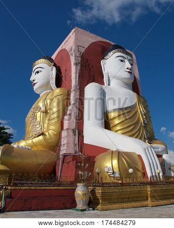 Four seated Buddhas in Kyaikpun Pagoda in Bago, Myanmar