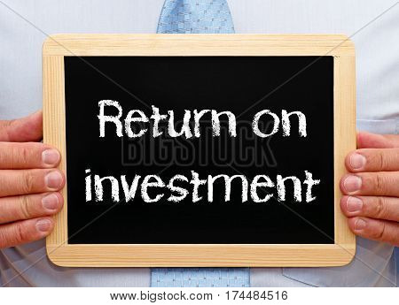 Return on investment - Businessman with chalkboard