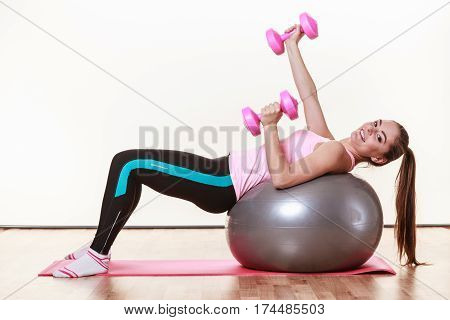 Sporty Young Woman At The Gym.