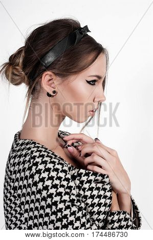 Portrait Of Cute Girl In Black And White Houndstooth Coat
