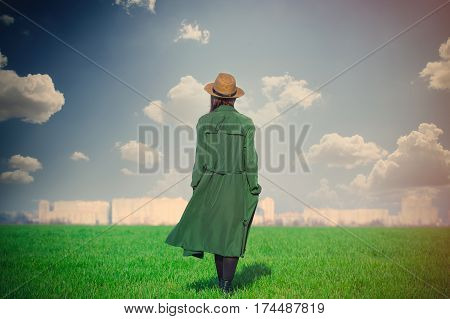 Beautiful Young Woman Standing On The Grass On The Wonderful Green Field