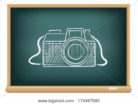 Education blackboard with drawing photographer camera. Studying photography in school.