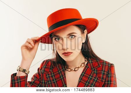 Portrait Of Young Stylish Girl. Fashion Portret Of Elegant Woman In Hat And Jacket. Studio Shot