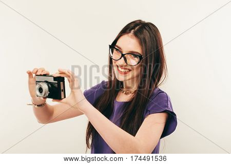 Young Smiling Woman Making A Photo Through Old Photo Camera. Photographer