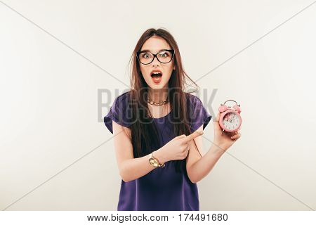 Young Fun Woman In Glasses With Alarmclock. Emotion
