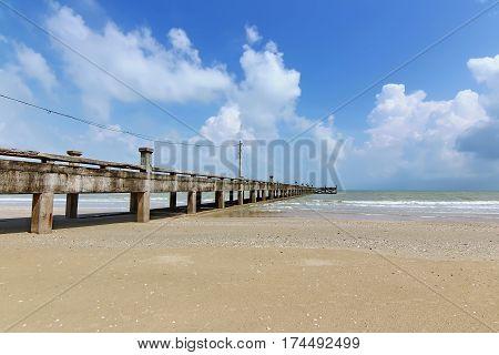 Long jetty into the sea in Nakhon si thammarat Thailand