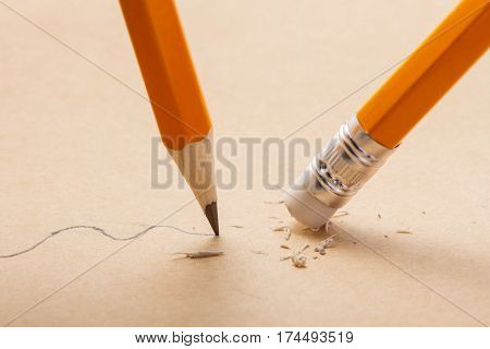 pencil draw a wavy line on paper and pencil eraser removing stripe. Business Breaking concept. Writing. Concept. School and education.