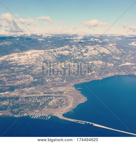 Aerial view of Kelowna BC in winter with bridge to West Kelowna Westbank over Okanagan lake.