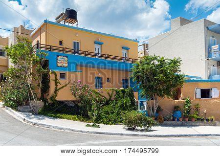 PALEOCHORA, CRETE, GREECE - JUNE 2016: Traditional Greek house near the road at Paleochora town on Crete island, Greece