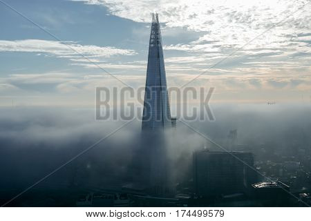 LONDON, UK - DECEMBER 29, 2016: London and Shard, the highest building in the city, consumed by fog, bird's eye view
