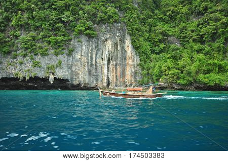Island in Thailand (Krabi) has clean beaches clear waters and beautiful stone.