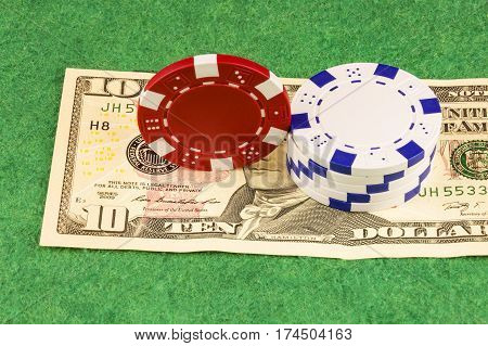 On the green baize is ten dollars and casino chips
