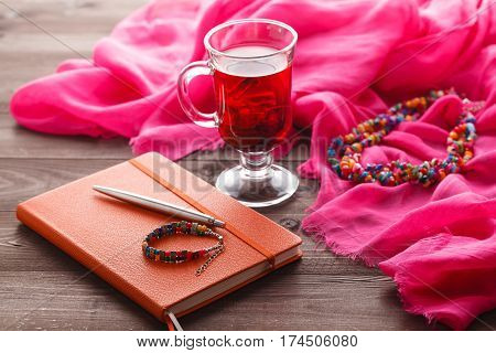 Hibiscus Tea And Pink Silk Shawl On Table