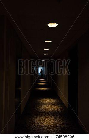 Silhouette of bride and bridegroom in dark corridor. Wedding