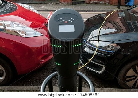 electric car charging to refuel at the charging station