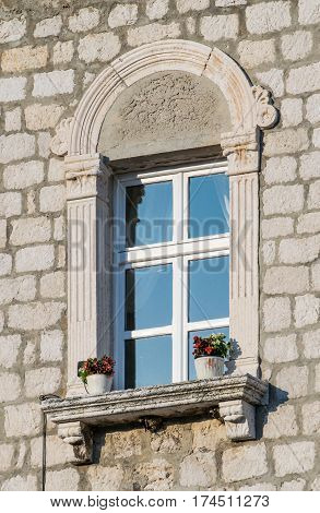 Window feature of a building in the historic center of Rab Croatian island.