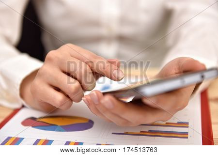 Businesswoman Touching Mobile Phone